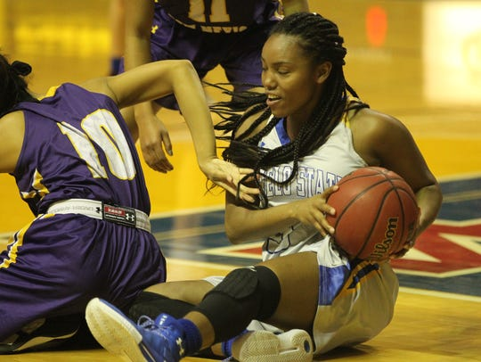 Angelo State University's Kynese Davis maintains control