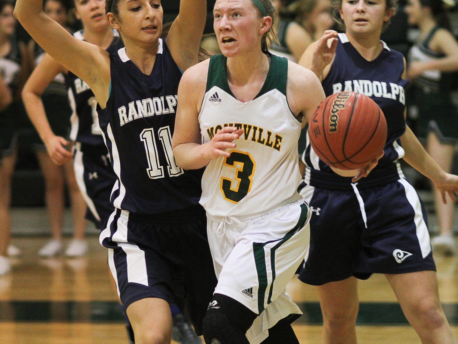 Keith A. Muccilli/CorrespondentMontville's Kelly O'Reilly (3) drives to the basket against Randolph's Jenni LaMancuso (11) during Tuesday's game. Montville's Kelly O'Reilly (3) goes to the hoop covered by Randolph's Jenni LaMancuso (11) in Montville on February 3, 2015. (Photo by Keith A. Muccilli/ Special to NJ Press Media)