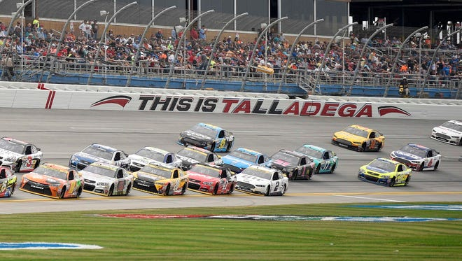 Sprint Cup Series drivers race around the 2.66-mile track at Talladega Superspeedway.