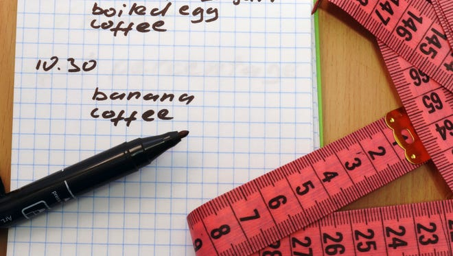 Keeping a food diary may help you lose weight.