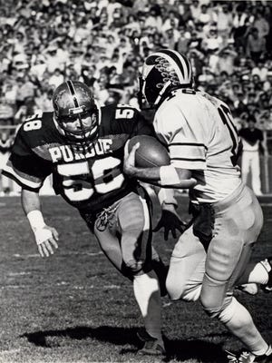 Former East great Brock Spack zeroes in on a Michigan running back while at Purdue. Spack started three years for the Boilermakers, ranks No. 3 on their all-time tackle list and was named first-team All-Big Ten and honorable mention All-American as a sophomore in 1981.