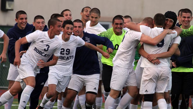 Byram Hills celebrates after defeating Nyack 3-2 in overtime in the Section 1 Class A final soccer match at Lakeland High School Oct. 28, 2017.
