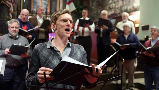 """Actor Scott Parkinson and the choir rehearses for """"All Is Calm"""" at St. Mary-in-the-Highlands Episcopal Church in Cold Spring. The play is a production of the Hudson Valley Shakespeare Festival."""