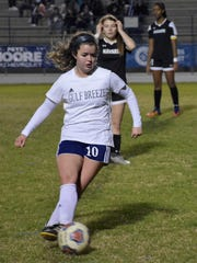 Gulf Breeze's Rainey Niles dribbles against Navarre on Jan. 19, 2018. Niles is committed to play at the University of Louisiana.