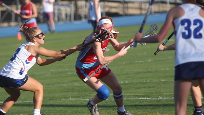 Arrowhead midfielder Abbey Lippold takes a stick from a WNS defender during a game on May 15, 2018.