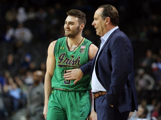Notre Dame's Matt Farrell (5) talks with Notre Dame Fighting Irish head coach Mike Brey during the second half of an ACC Conference Tournament game