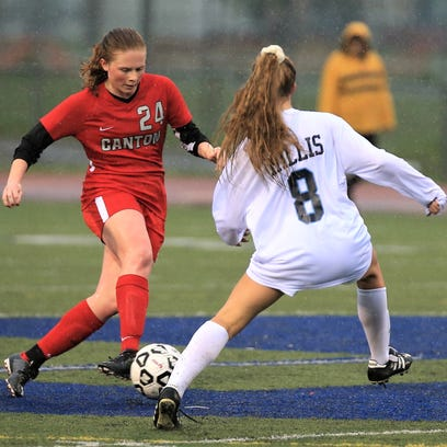 Canton's Kiera Savage (left) goes on the attack against