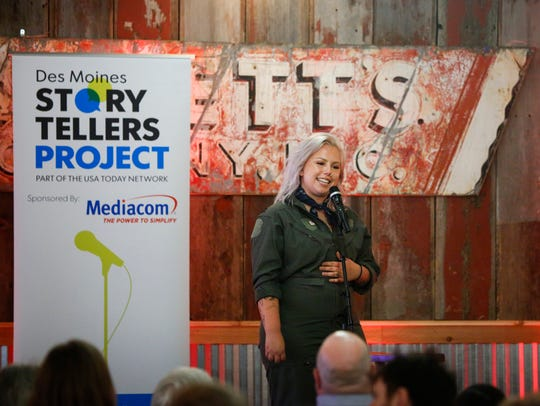 Nicole Leth tells a story at the Des Moines Story Tellers