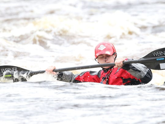 Ari Butte, of Stevens Point, kayaks Saturday, May 13,