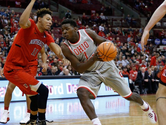 Ohio State's Jae'Sean Tate, right, drives the lane against Northeastern's Jeremy Miller during the second half of an NCAA college basketball game Sunday, Nov. 19, 2017, in Columbus, Ohio. (AP Photo/Jay LaPrete)