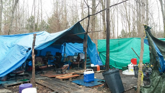 One of the tarp shelters before it was torn down with others like it at a homeless encampment in a wooded area off Del. 273.