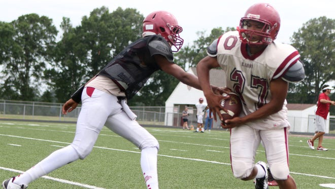 Local high school football will be the topic at a coaches roundtable and hamburger fundraiser Tuesday at First United Methodist Church in West Monroe. Here Wilijah Naylor and Jabari Johnson of the Ouachita Lions work out at spring practice.