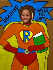 Brynn Greenwood, 9,  poses with a cutout during the Soar with Reading program at Andrew Buchanan  Elementary School. The event sponsored by Frankln County Reading Council Community Service Project helps studentss develop a love of reading.