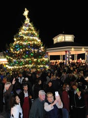 A couple takes a selfie after the Rehoboth Beach Christmas Tree Lighting at the Bandstand last year.