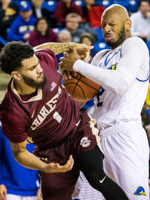 Delaware's Barnett Harris (right) fights for a rebound with Charleston's Grant Riller (left) in the second half of the University of Delaware's 65-56 loss to the College of Charleston at the Bob Carpenter center in Newark on Monday night.