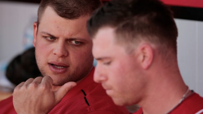 Cincinnati Reds catcher Devin Mesoraco (39), left, talks with Cincinnati Reds starting pitcher Anthony DeSclafani (28) during the Cactus League game between the Cleveland Indians and Cincinnati Reds, Thursday, March 3, 2016, at Goodyear Ballpark, in Goodyear, Arizona. The Reds defeated the Indians 9-1.