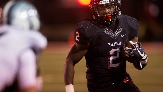 Maryville running back Isaiah Cobb (2) runs with the ball during a high school football game between Maryville and Farragut on Friday, Nov. 10, 2017.