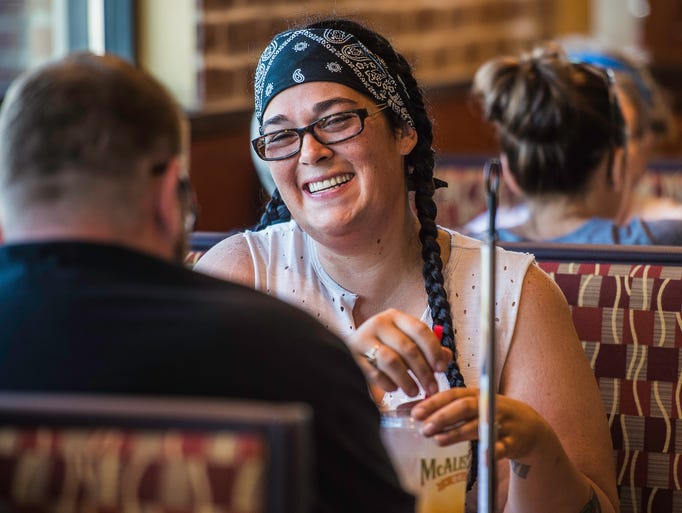 A customer eats at the new McAlister's Deli, 3801 National