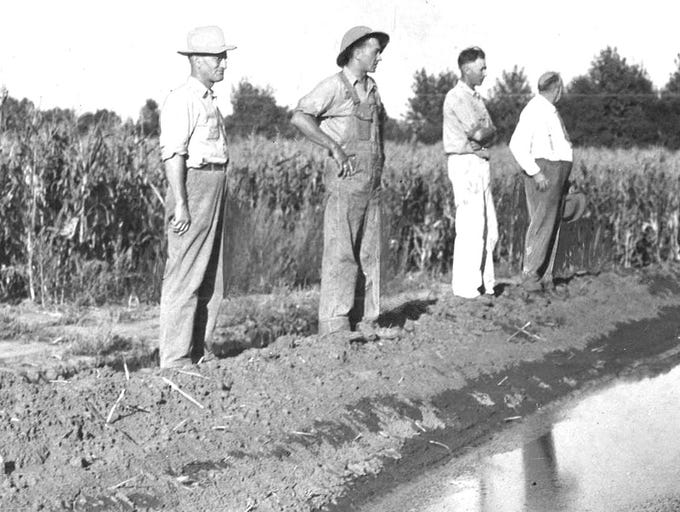 "Shown in 1937 on the bank of the main irrigation ditch on Fred Shaw's farm near Elliott are Elmer and Carl Carlson, Peter Hansen and C.F. Carlson. For more photos from the Register's archives, subscribe here: <a href=""http://bit.ly/2KZwECu"">http://bit.ly/2KZwECu</a>"