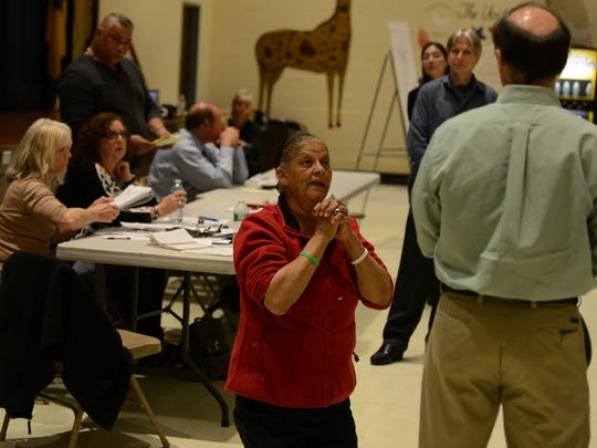 Longtime resident Vivian Milligan pleads with EPA officials to excavate polluted soil at the O'Connor Disposal Area at a public meeting in April.