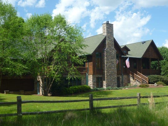 This Nolensville mini farm has a custom lodge-style home with four bedrooms and 5,451 square feet.