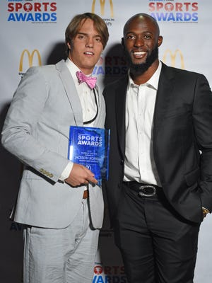 Ruston swimmer Jackson Boersma poses with former LSU running back Leonard Fournette during The Times Sports Awards.