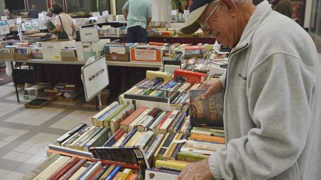 Visalia native, Bob Hargrove browsed through the history section at the AAUW book sale Wednesday afternoon at the Sequoia Mall.