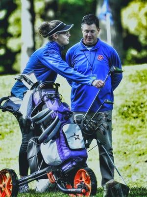 Lenawee Christian girls golf coach Craig Morr talks to Lauren Swiggum before the 2019 Division 4 state championship meet.