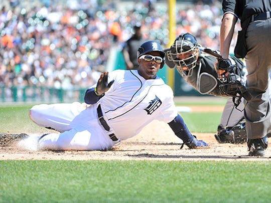Rajai Davis is out at home on a fielder's choice grounder to third by Ian Kinsler.