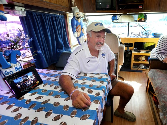 Danny Farrer, left and his wife Dawn Farrer the owners of the Hillbilly Hilton, talk about their MTSU tailgating experience at the bus, on Thursday, Sept. 1, 2016.