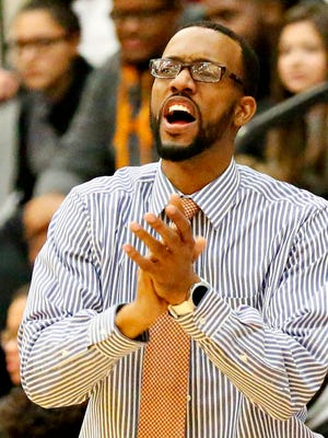 William Penn Head Coach Clovis Gallon looks on during The York High Tip-Off Boys Basketball Tournament championship game against Reading at William Penn Senior High School in York City, Sunday, Dec. 11, 2016. Reading would win the game 73-66. Dawn J. Sagert photo