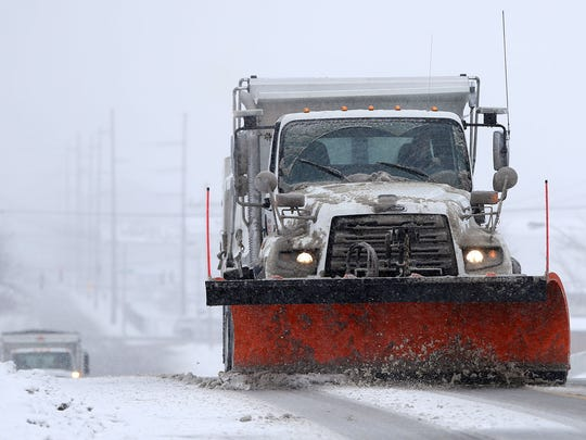 A plow driver clears snow off the roads during a snow storm in South Salt Lake on Friday, Feb. 23, 2018.