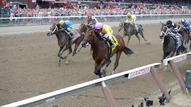 Magna Light (4) finished first in Saratoga's Sanford Stakes for 2-year-olds Saturday. But Starlight Racing's Uncle Vinny (11) inherited the victory when Magna Light was determined to have impeded Percolator (10 on rail in black and white silks).