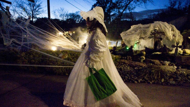 8-year-old Ava Buonanno of Cherry Hill is dressed as a Victorian ghost as she trick-or-treats at the elaborately decorated home of Mario and Denise Papaneri located on Weather Vane Drive in Cherry Hill.  11.05.12