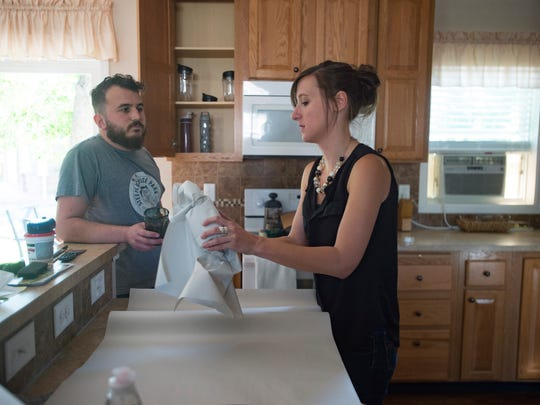 Jill Arnold and her boyfriend Levi Sanchez work to pack up their kitchen in their rental home of four years in west Fort Collins on Wednesday, July 11, 2018. The couple are moving into their own home after searching for high and low for something in their budget.