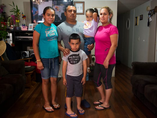 Alberto Librado, center, stands with his family from left, Sheryln, 11, Abdiel, 5, Jeylani, 3, and his wife Aneth, in their White Pine, Tenn. home July 3, 2018. He was detained by U.S. Immigration and Customs Enforcement agents when they raided the Southeastern Provision meat-packing plant where he worked outside Bean Station in April.