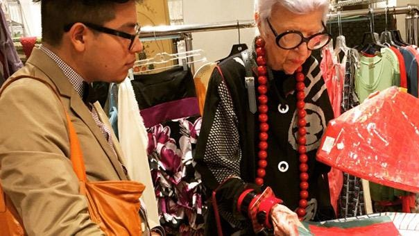 """Iris Apfel instructs University of Texas at Austin student Alfonso Estrada during a UT in NYC excursion. The recently published """"IRIS The Coloring Book"""" raises money for scholarships for the program, which is curated and led by Apfel."""