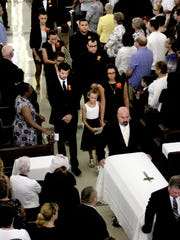 6/22/15 - Funeral - Tamara Wilson-Seidle's children follow her casket out of Mother of Mercy Church in Asbury Park. Tamara was shot and killed by her ex-husband, a Neptune Township police sergeant, last week in Asbury Park.