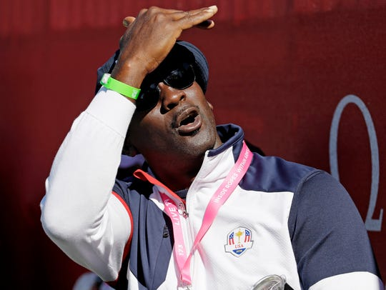 Michael Jordan, shown watching a four-ball match at