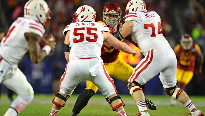 Nebraska center Paul Thurston (55) provides pass protection against Southern California during the 2014 Holiday Bowl in San Diego. Thurston signed with CSU on Wednesday as a graduate transfer.