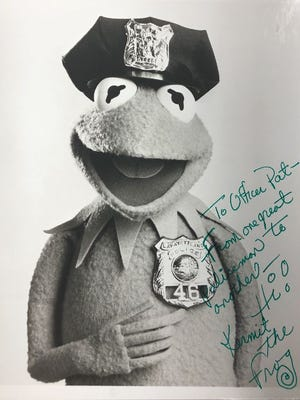 A photo signed by Kermit the Frog, who was appointed an honorary member of Lafayette Police Department in 1978, addressed to retired LPD Officer Patrick Hughes.