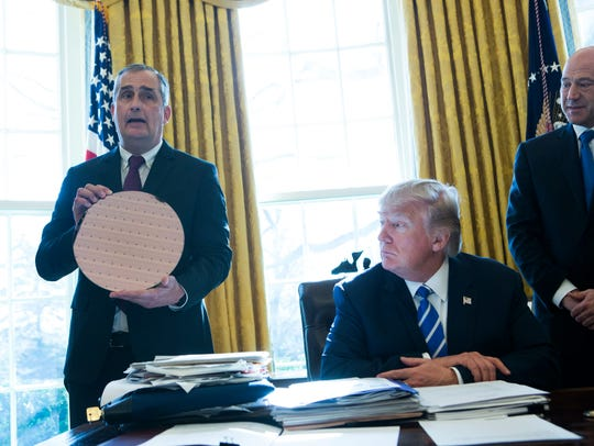 Intel CEO Brian Krzanich speaks during a meeting with