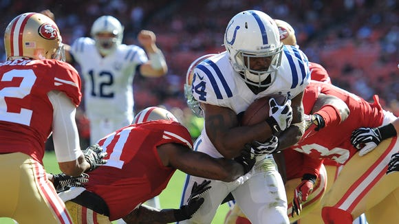 Colts running back Ahmad Bradshaw, center, rushes for a touchdown during the fourth quarter. Indianapolis Colts play the San Francisco 49ers Sunday afternoon at Candlestick Park in San Francisco CA.
