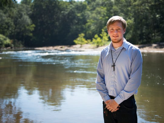 Jackson Payne stands by the Saluda River where he will be hosting a fundraiser for his friend who died of leukemia on Wednesday, July 26, 2016.