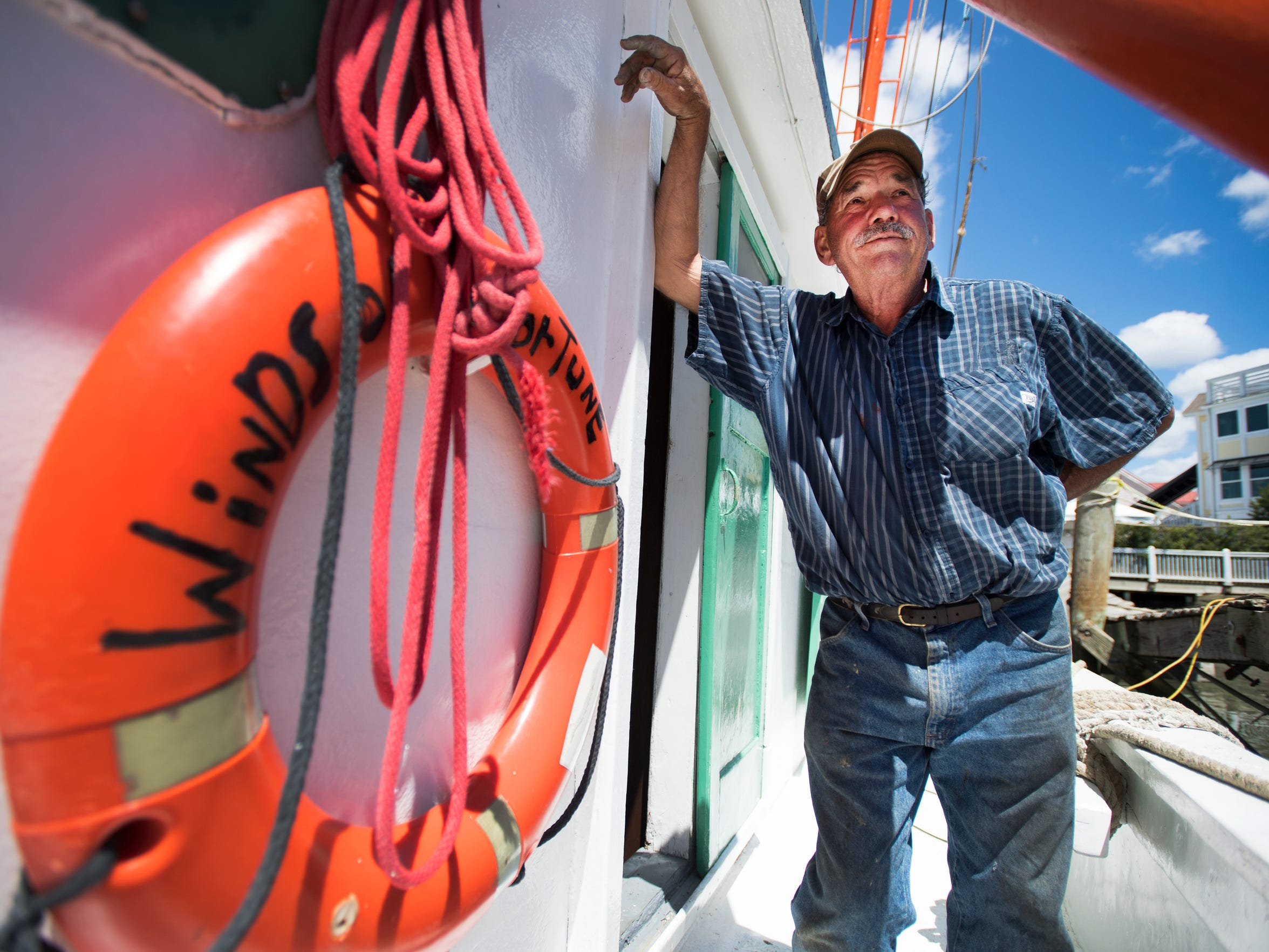 Wayne Magwood is pictured on his boat, Winds of Fortune,