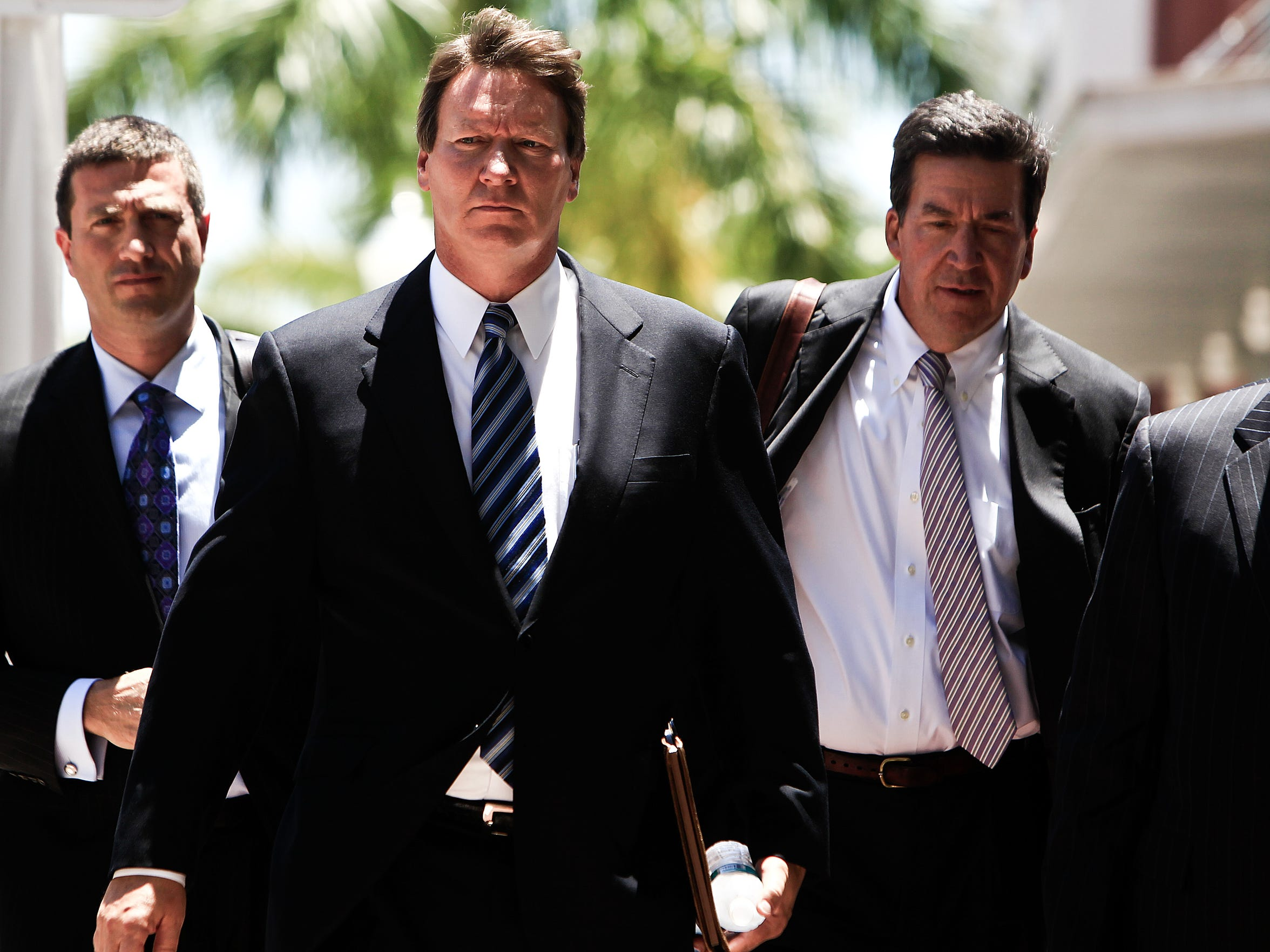 Jerry Williams, the ex-CEO of Orion Bank, second from left, walks into his sentencing at the federal courthouse in Fort Myers on Tuesday June 12, 2012.