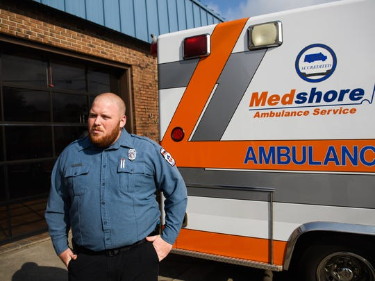 Charlie Partain, 26, a paramedic with MedShore, stands next to his truck during a shift in Anderson on Thursday, July 31, 2018.