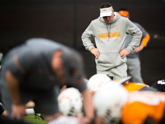 Tennessee head coach Butch Jones watches his team warm