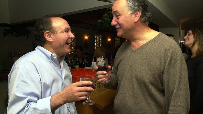 Ernesto Capalbo, owner of Ernesto's in White Plains, shares a laugh with Peter Viviano, a captain with the White Plains Police Department, during a wine tasting contested at Ernesto's in 2001.