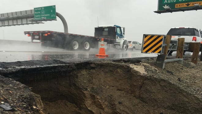 Traffic moves on southbound Interstate 15 in Jurupa Valley, where January rainstorms caused erosion. There was about $1 million in damage to Inland Empire freeways because of the heavy winter storms.